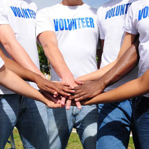 volunteer-hands-in